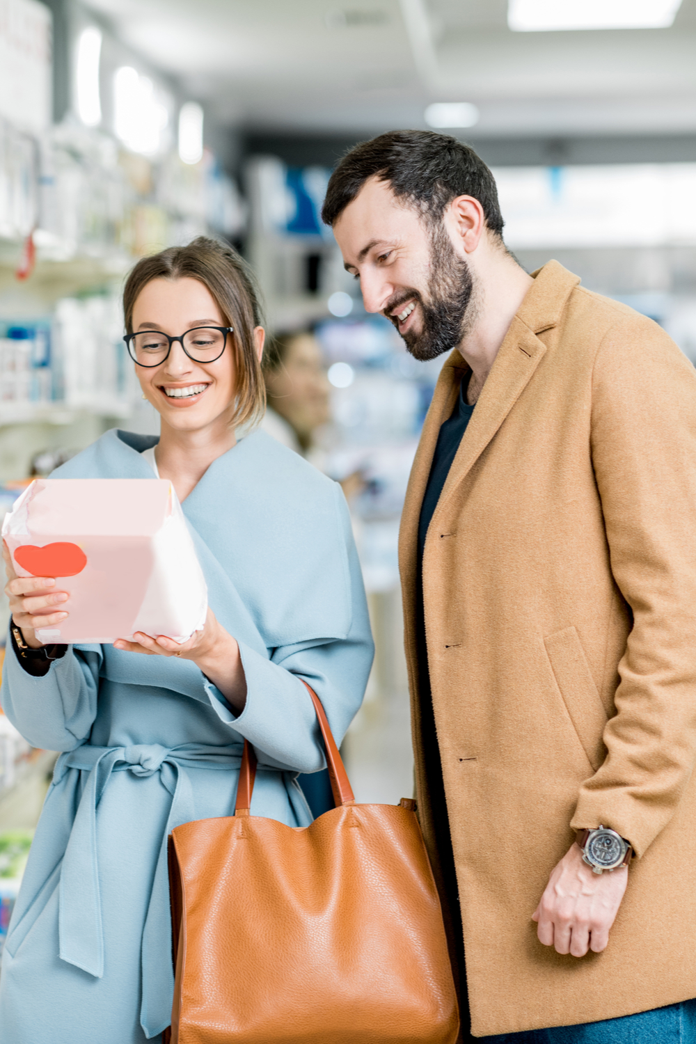 young couple choosing FMCG product